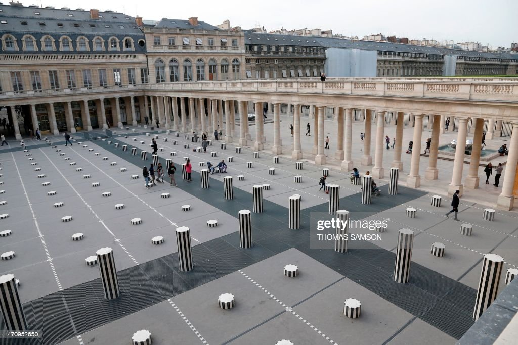 People play and walk around the Buren's columns in the gardens of the Palais Royal in Paris on April 24 2015 AFP PHOTO / THOMAS SAMSON