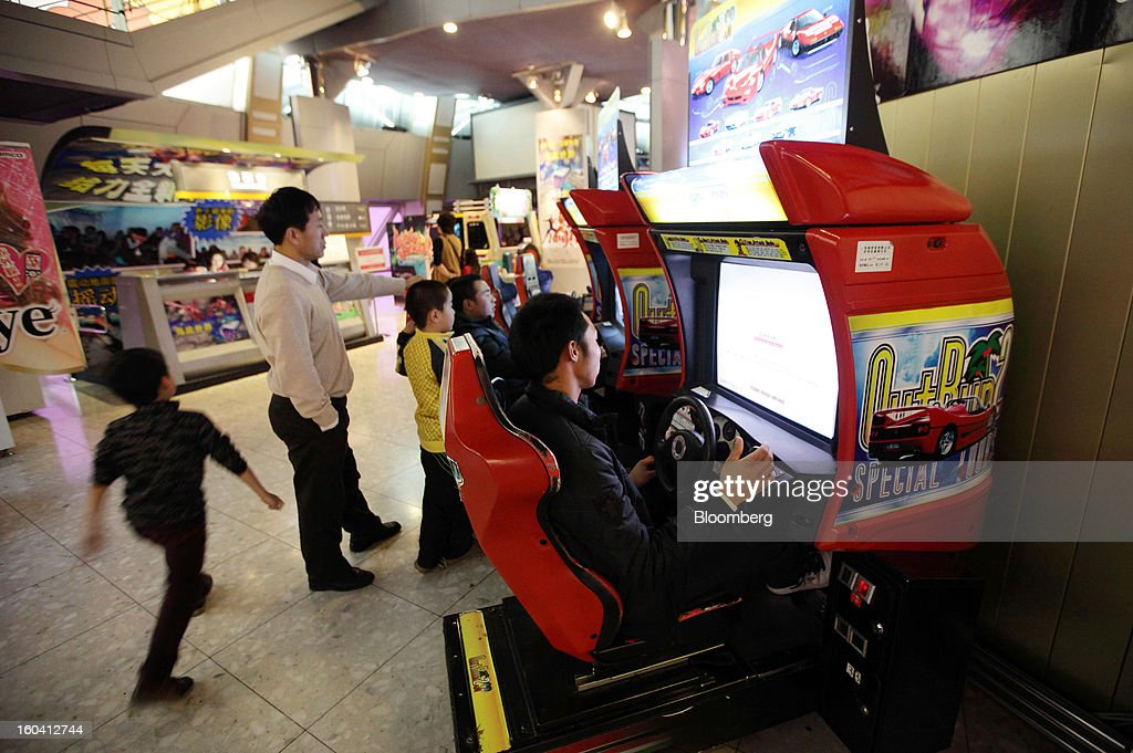 People play arcade games inside the Oriental Pearl Tower in the Pudong area of Shanghai, China, on Wednesday, Jan. 30, 2013. China's economic growth accelerated for the first time in two years as government efforts to revive demand drove a rebound in industrial output, retail sales and the housing market. Photographer: Tomohiro Ohsumi/Bloomberg via Getty Images