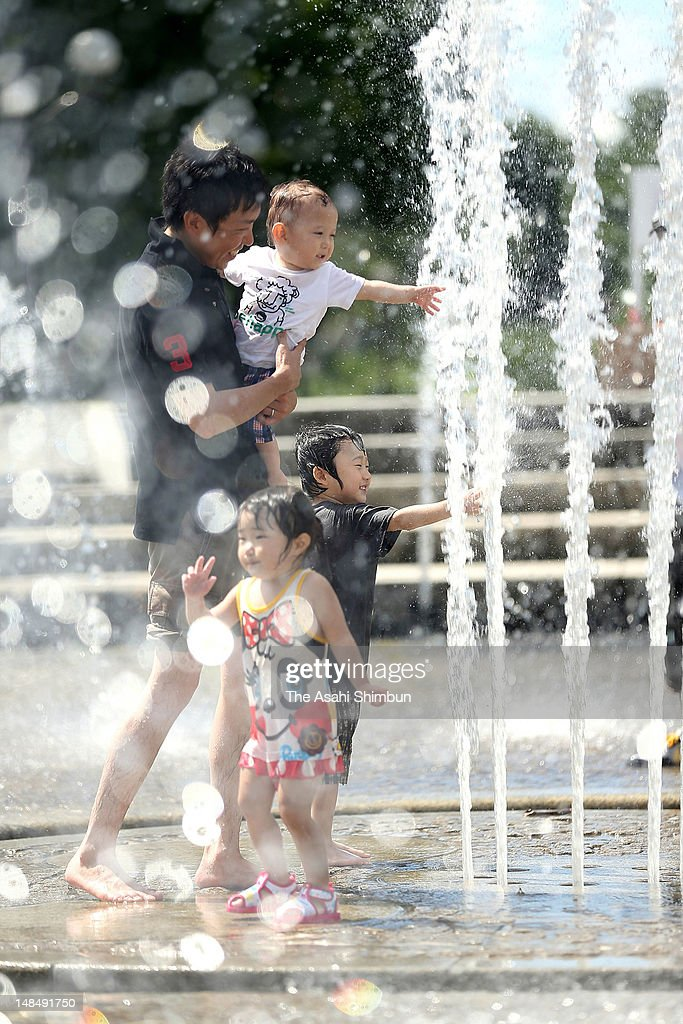 People play at a fountain on July 17, 2012 in Osaka, Japan. Japan Meteorological Agency announced that the rainy season seems finish in most of the area in Japan.