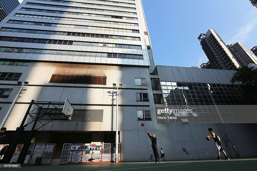 People play basketball on December 19, 2013 in Hong Kong, China. Hong Kong leads the world in economic freedom according to the Heritage Foundation.