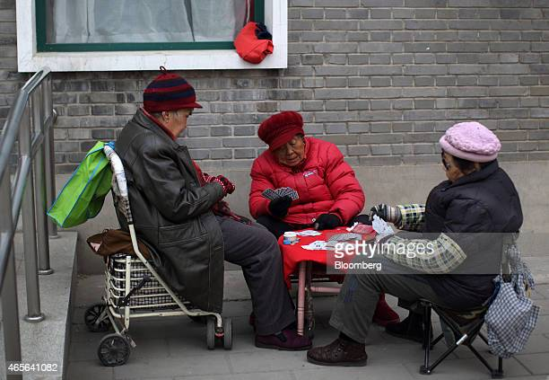 People play cards at Tiantan Park in Beijing China on Sunday March 8 2015 China set the lowest economic growth target in more than 15 years and...