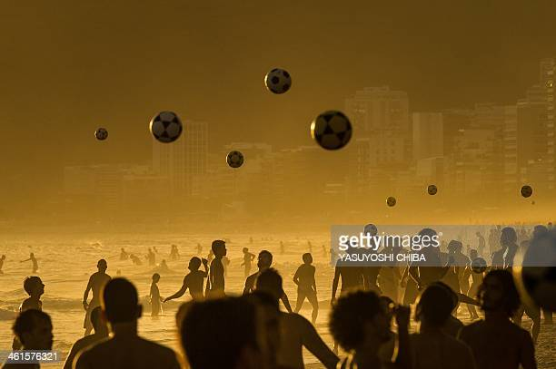 People play football at sunset at Ipanema Beach in Rio de Janeiro Brazil on January 9 2014 AFP PHOTO / YASUYOSHI CHIBA