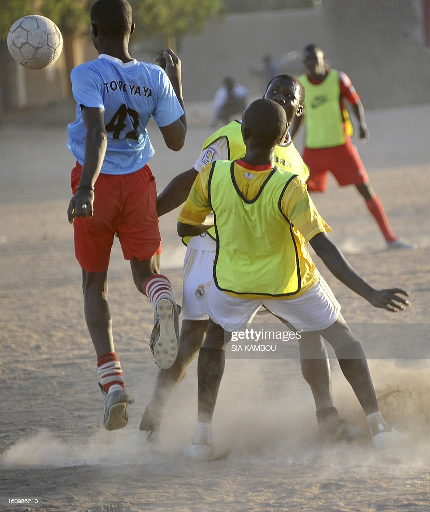 People play football in a district of the city of Gao on February 7, 2013. The French air force struck in January 2013 the northern Malian city of Gao, which had been controlled by the Al-Qaeda offshoot MUJAO, destroying Islamist bases and forcing the insurgents to flee. The town had for more than nine months been under the control of the Movement for Oneness and Jihad in West Africa, an offshoot of Al Qaeda in the Islamic Maghreb (AQIM). MUJAO had enforced an extreme form of Islamic law and the city of Gao, one of the three main cities in northern Mali, with Kidal and Timbuktu, had seen some of the worst punishments meted out in the name of sharia.