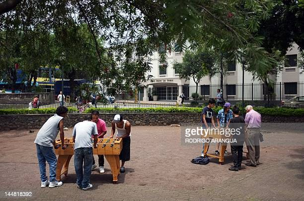 People play football table at Spain square in San Jose on May 19 2012 The Costa Rican Ministry of Culture and Youth is launching cultural activities...