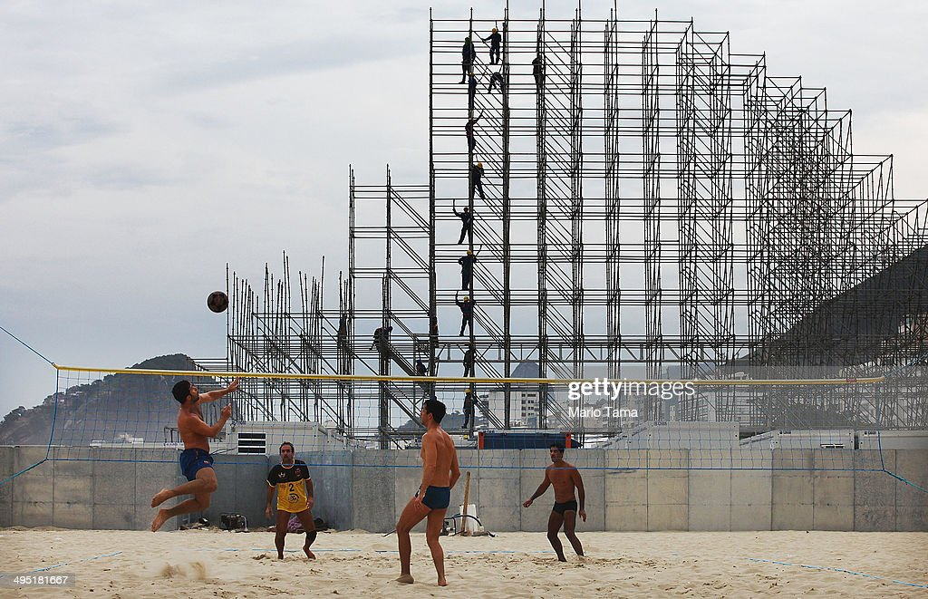 People play footvolley, a form of soccer mixed with volleyball, near construction of the FIFA Fan Fest stage on Copacabana Beach on June 1, 2014 in Rio de Janeiro, Brazil. Brazil has won five World Cups, more than any other nation. The 2014 FIFA World Cup kicks off June 12 in Brazil.