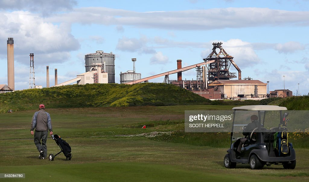 People play golf near the former Corus steelworks in Redcar, north-east England on June 27, 2016. Top Brexit campaigner Boris Johnson sought Monday to build bridges with Europe and with defeated Britons who voted to remain in the EU in last week's historic referendum. Britons voted by 52 percent to 48 percent in favour of leaving the European Union in a June 23 vote that exposed deep divisions in the country and sent shockwaves through the world. / AFP / SCOTT