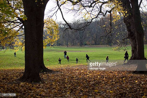 People play in a field during the mild autumn weather in Prospect Park on November 27 2011 in the Brooklyn borough of New York City The Thanksgiving...
