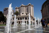 People play in a fountain outside of the Fairmont Hotel August 29 2007 in downtown San Jose California The US Census Bureau released its newest...