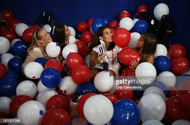 People play in balloons after Republican presidential candidate former Massachusetts Gov Mitt Romney accepted the nomination during the final day of...