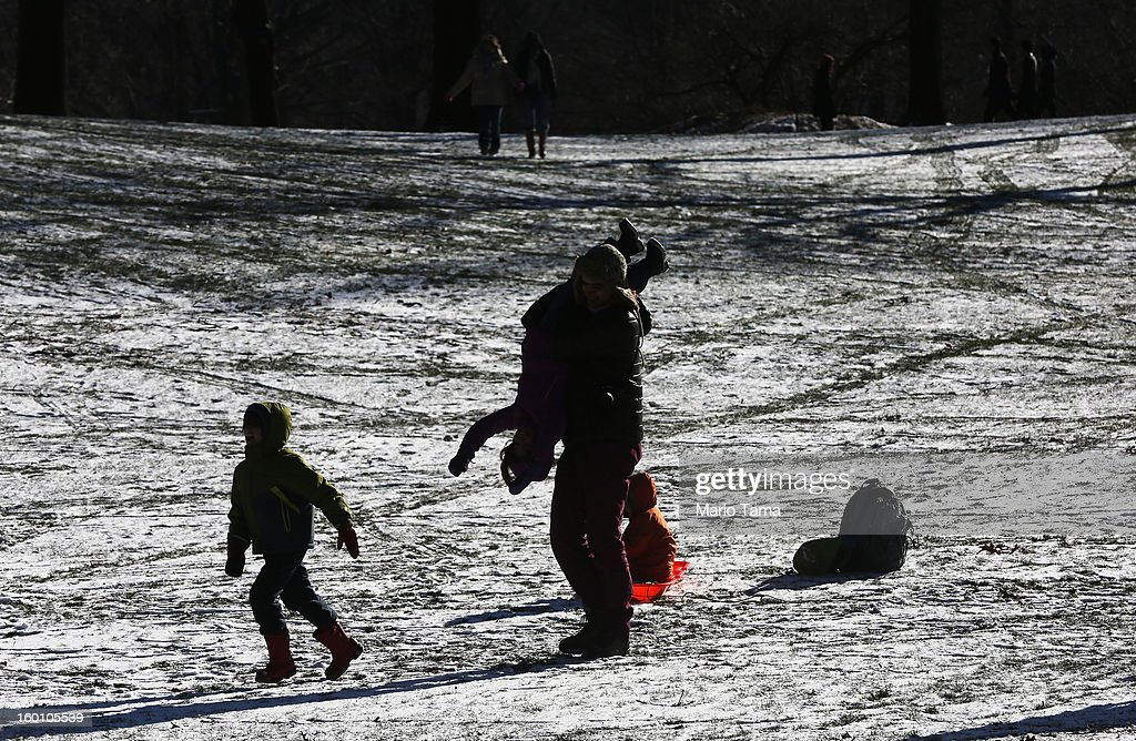 People play in the snow at the Winter Jam in Central Park on January 26, 2013 in New York City. The annual festival brings skiing, snowboarding and snowshoeing to New Yorkers with free equipment.