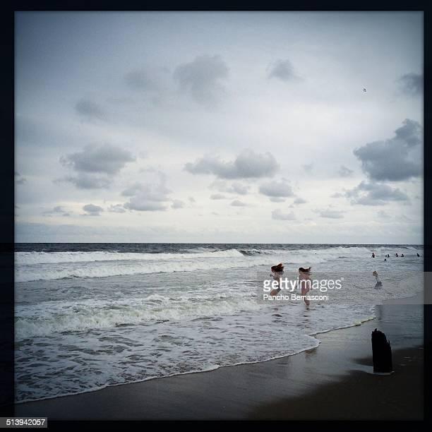 People play in the surf of the Atlantic Ocean in Ocean Grove NJ
