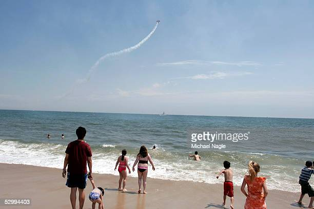 People play in the water during the New York Airshow on May 28 2005 at Jones Beach in Wantagh New York The airshow which featured the Air Force...