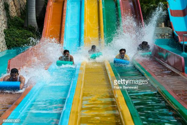 People play in water slides at Wonder La the big amusement park outside of Bangalore The park features a wide variety of attractions including some...
