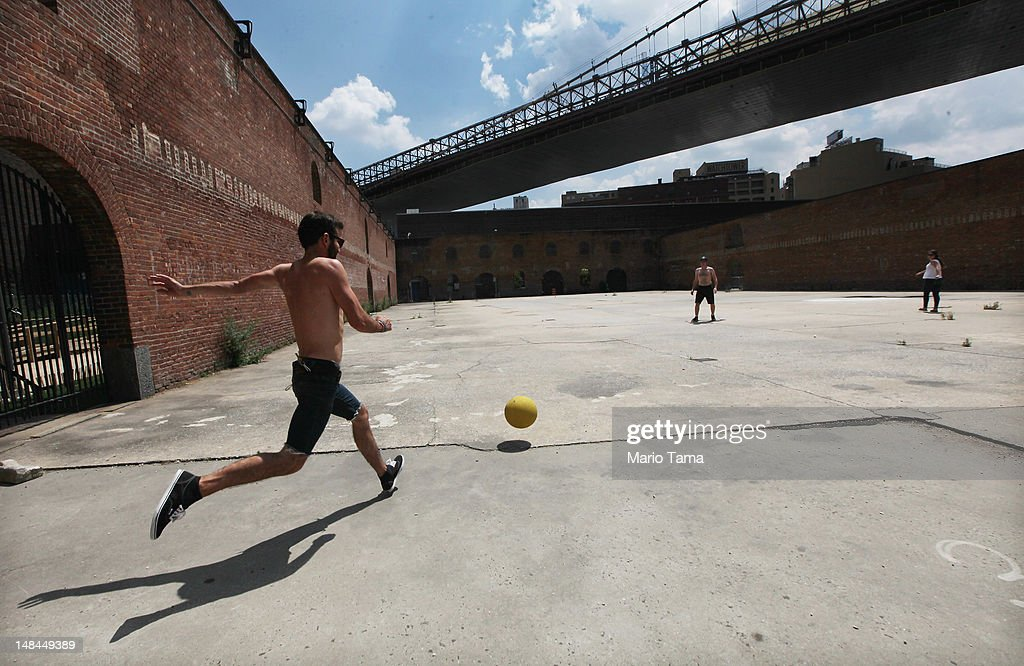 People play kickball in Brooklyn Bridge Park on July 16, 2012 in the Brooklyn borough of New York City. A heat advisory was issued in the city again today as high temperatures were expected in the 90's the next three days.