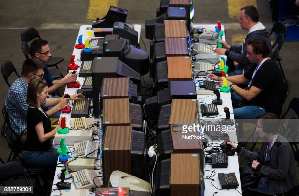 People play oldschool video games on Pixel Heaven fair in Warsaw 26 May Poland
