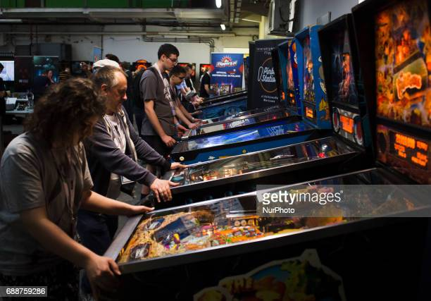 People play on flipper machine on Pixel Heaven fair in Warsaw 26 May Poland