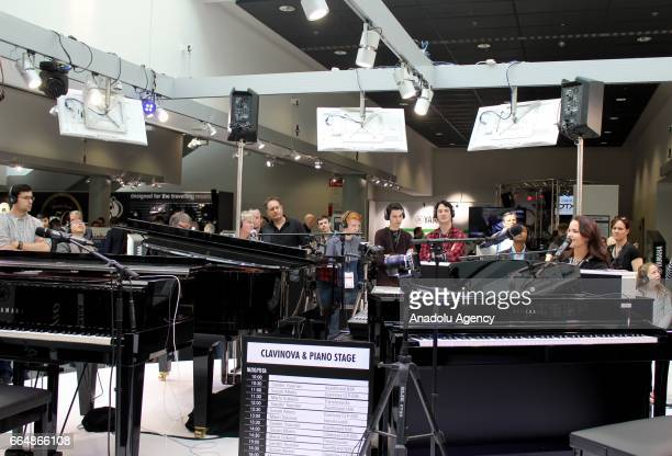 People play pianos during the International Trade Fair for musical instruments sheet music music production and marketing 'Musikmesse' organized by...
