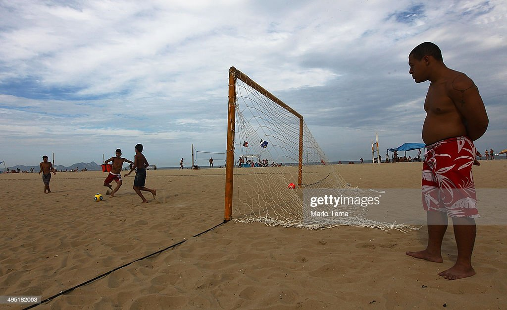 People play soccer on Copacabana Beach on June 1, 2014 in Rio de Janeiro, Brazil. Brazil has won five World Cups, more than any other nation. The 2014 FIFA World Cup kicks off June 12 in Brazil.