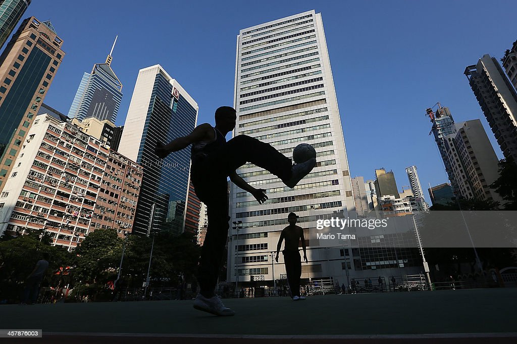 People play soccer on December 19, 2013 in Hong Kong, China. Hong Kong leads the world in economic freedom according to the Heritage Foundation.