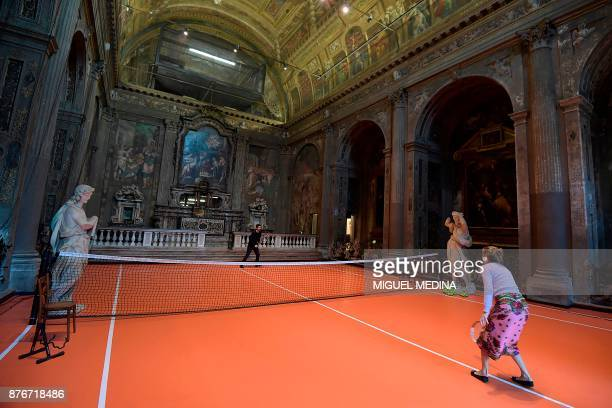 People play tennis on the US artist Asad Raza's new piece of art a tennis court called 'untitled ' inside the San Paolo Converso church in Milan...