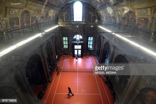 TOPSHOT People play tennis on the US artist Asad Raza's new piece of art a tennis court called 'untitled ' inside the San Paolo Converso church in...