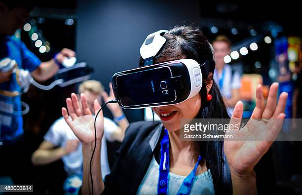 People play video games at the Gamescom 2015 gaming trade fair during the media day on August 5 2015 in Cologne Germany Gamescom is the world's...