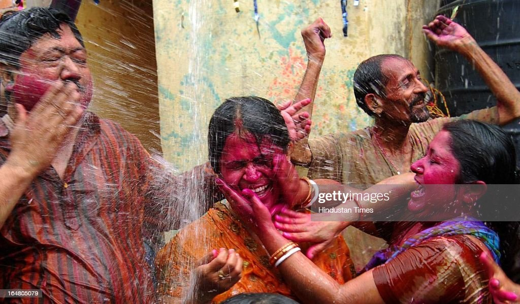 People play with colours and dance during Holi festival celebration on March 28, 2013 in Allahabad, India. Holi, festival of color is Hindu religious festival also called Basantotsav or spring festival as it mark the arrival of spring. People gather together to play colors, sing and dance to traditional tunes and eat sweets specially Gujiyas.