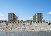 People playing and enjoying at the Rockaway Beach in Queens New York August 24 2014