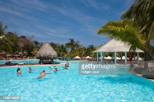 people playing aqua volleyball in swimming pool at paradisus rio de oro resort playa esmeralda