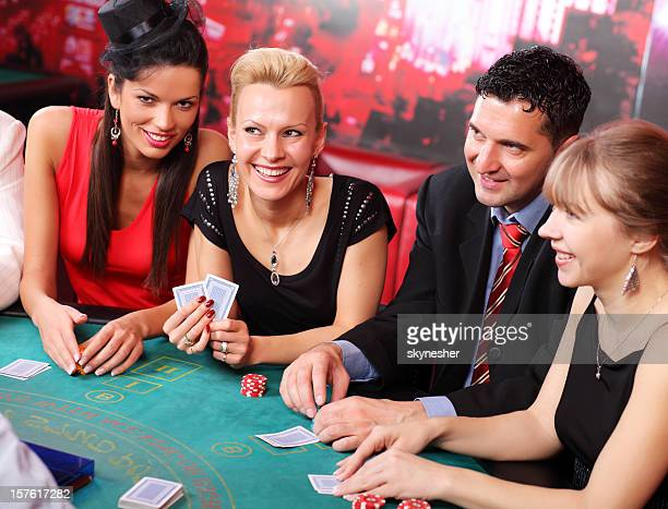People playing at the Blackjack table in casino.