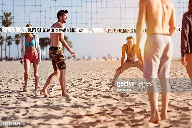People playing beach volleyball
