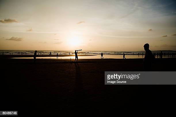 People playing cricket on mumbai beach