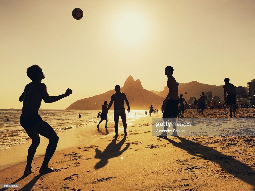 People playing football at Ipanema Beach in Rio : Bildbanksbilder