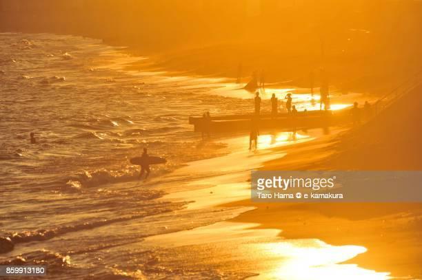 People playing on the sunset beach in Kamakura city in Kanagawa prefecture in Japan