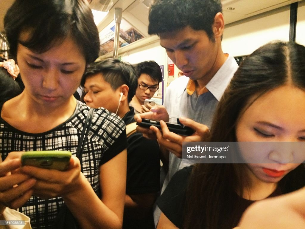People playing with smartphones and ignoring each other