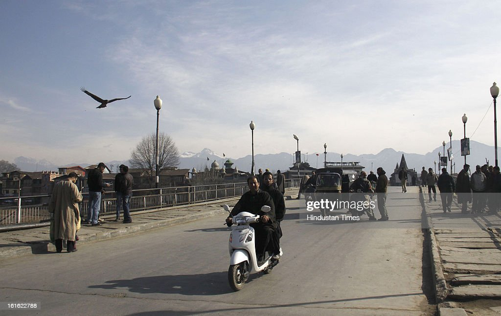 People plying on road at Amira Kadal after curfew was lifted from some parts of valley after five days on February 13, 2013 in Srinagar, India. Curfew was was imposed by the authorities last Saturday to control Law and order situation after the execution of Parliament attack convict Afzal Guru.