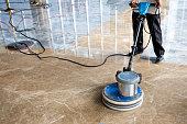 people polishes floor indoors