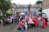 People pose as they enjoy a Diamond Jubilee party street party in Lysias Road Clapham on June 2 2012 in London England For only the second time in...