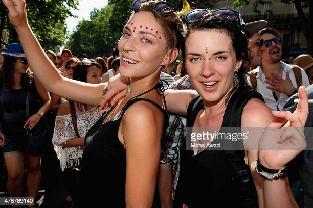 People pose during the annual Gay Pride Parade on June 27 2015 in Paris France The United States Supreme Court legalized gay marriage across the...