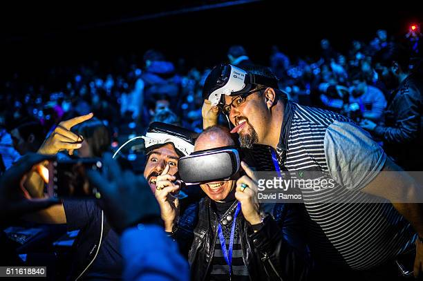 People pose for a picture as they wear Samsung Gear VR devices during the presentation of the new Samsung Galaxy S7 and Samsung Galaxy S7 edge on...