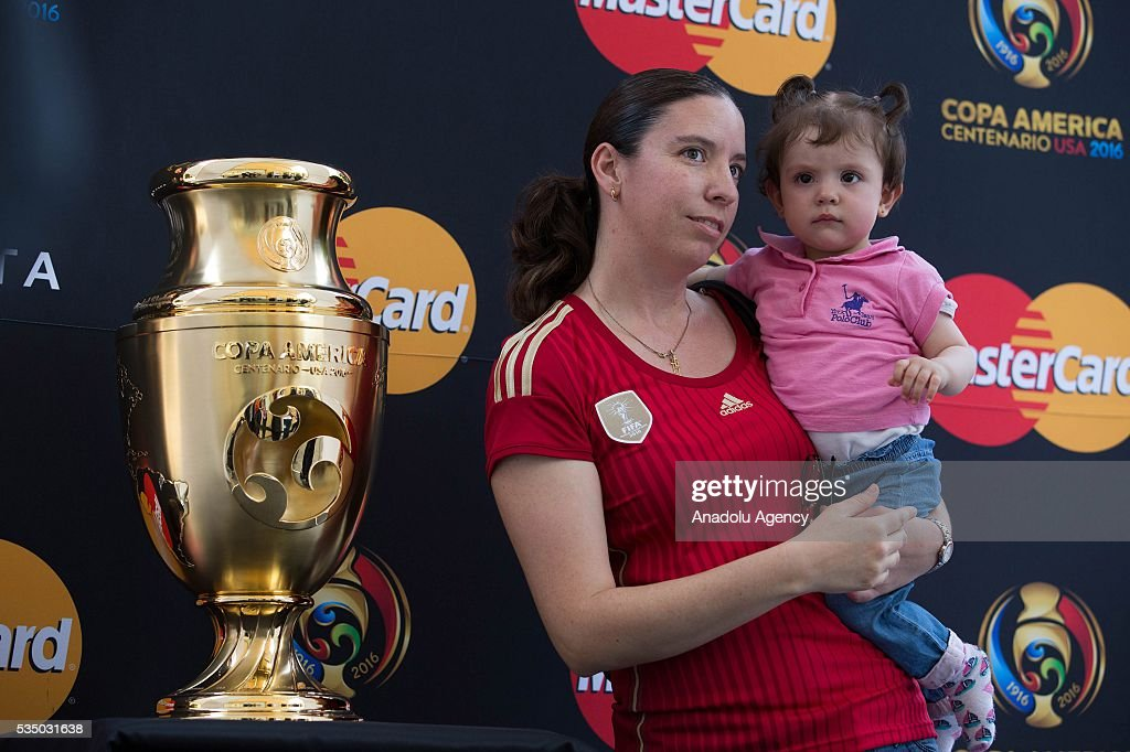 People pose for a picture with the Copa America Centenario Trophy during the Trophy Tour in Mexico City, Mexico on May 28, 2016. Copa America Centenario will be held in the United States from June 3 to 26, will also be the first time that the Copa America will be contested outside South America.