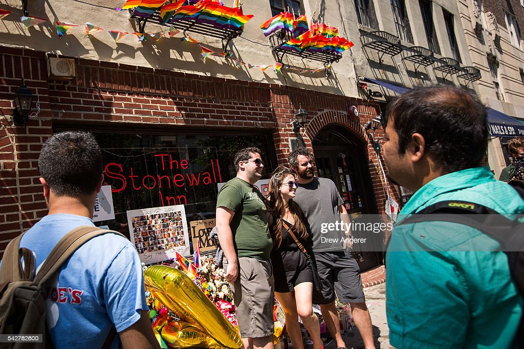 People pose for photographs in front of the Stonewall Inn on June 24, 2016 in New York City. President Barack Obama designated Stonewall Inn and approximately 7.7 acres surrounding it as the first national monument dedicated 'to tell the story of the struggle for LGBT rights.' The tavern is considered the birthplace of the modern gay rights movement, where patrons fought back against police persecution in 1969.