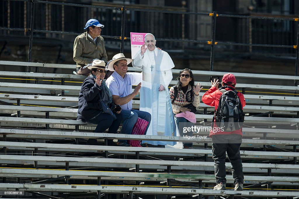 People pose for pictures with a life-size cutout of Pope Francis at Zocalo main square on February 13, 2016 in Mexico City, Mexico. Pope Francis will be on a five days visit in Mexico from February 12 to 17 where he is expected to visit five states.