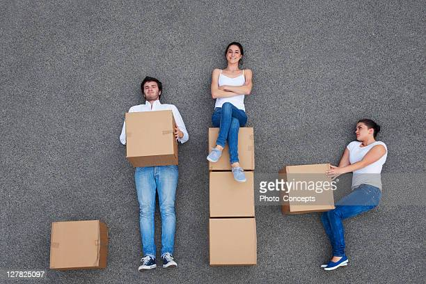 People posing with cardboard boxes