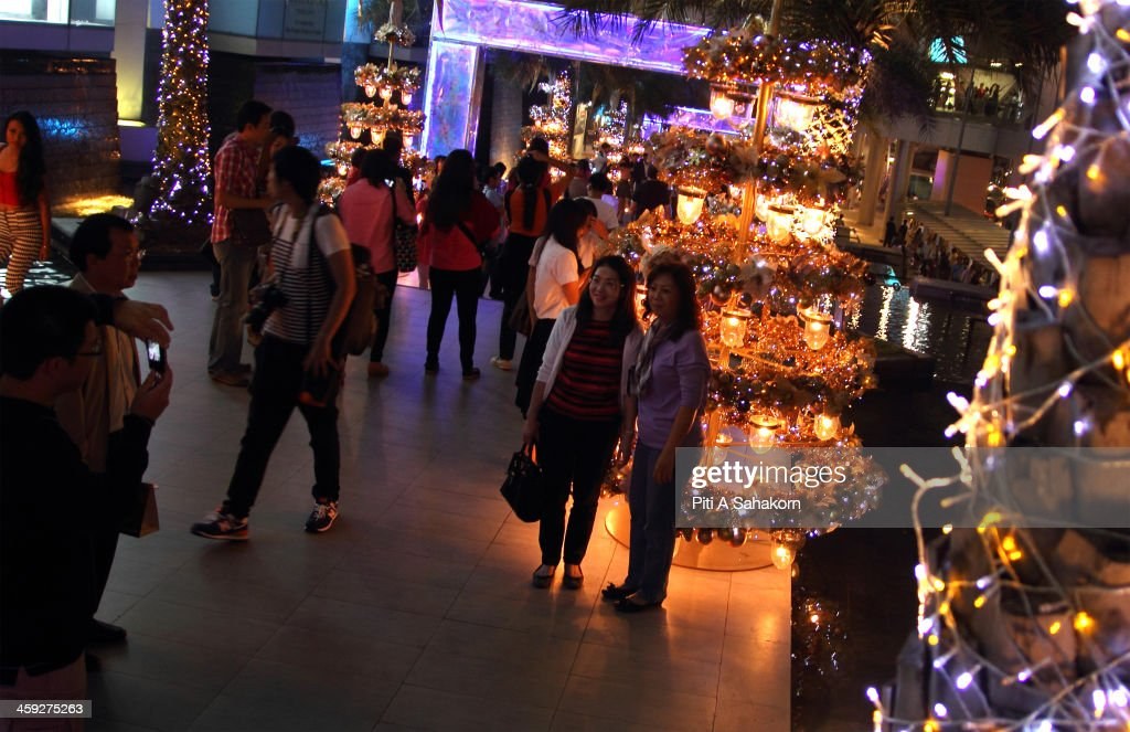 People posing with the display of Christmas lights at Siam Paragon shopping mall in Bangkok.