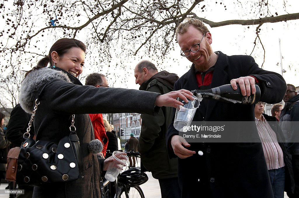 People pour a drink as others celebrate following the announcement of the former British Prime Minister Margaret Thatcher's death in Brixton on April 8, 2013 in London, England. Lady Thatcher has died this morning following a stroke aged 87. Margaret Thatcher was the first female British Prime Minster and governed the UK from 1979 to 1990. She led the UK through some turbulent years and contentious issues including the Falklands War, the miners' strike and the Poll Tax riots.