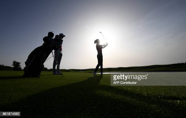 TOPSHOT People practice golf during the 2018 Ryder Cup media day on october 16 2017 at the Golf National in Guyancourt near Paris the venue of the...