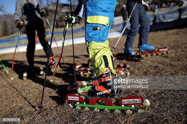 People practice grass skiing in San Sicario Alps Region on December 30 due to lack of snow In a season traditionally associated with iceskating...