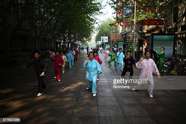 People practice tai chi in the East Nanjing Road area in Shanghai China on Tuesday April 28 2015 Yuan forwards headed for their best month since 2012...