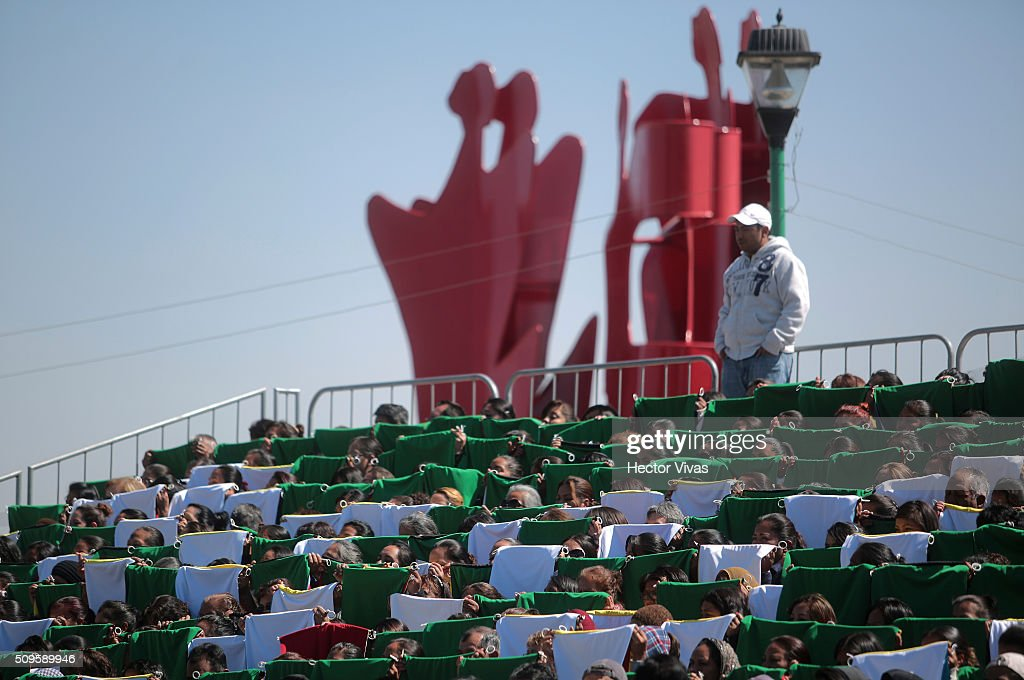 People practice with colorful banners to welcome Pope Francis near the esplanade where Pope Francis will give a mass for 300 thousand people during the preparations ahead the visit of Pope Francis to Mexico at Las Americas on February 11, 2016 in Ecatepec, Mexico.